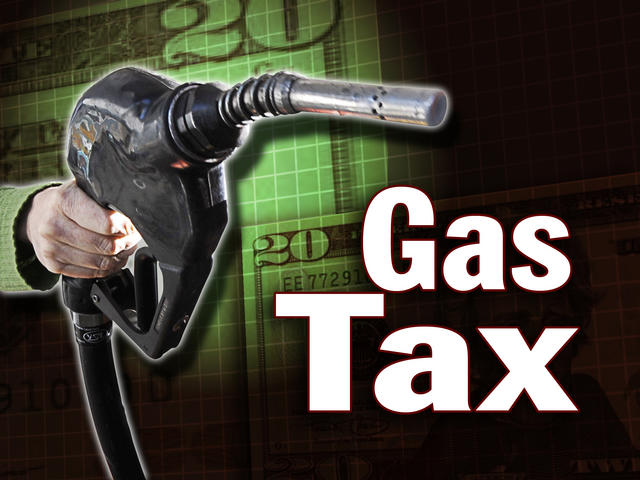 Picture of a hand holding a gas handle with Gas Tax overlaid on the image