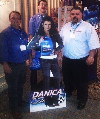 Dennis K. Burke, Boston employees around a Danika Patrick cardboard cutout advertising PEAK products