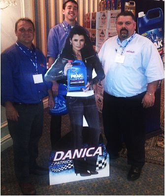 Dennis K. Burke, Boston employees around a Danika Patrick cardboard cutout advertising PEAK products