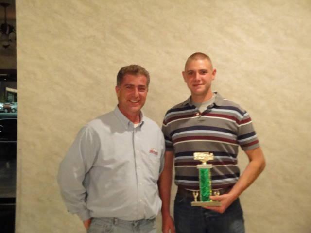 matt manoli  with driver joe buckley recieving an award