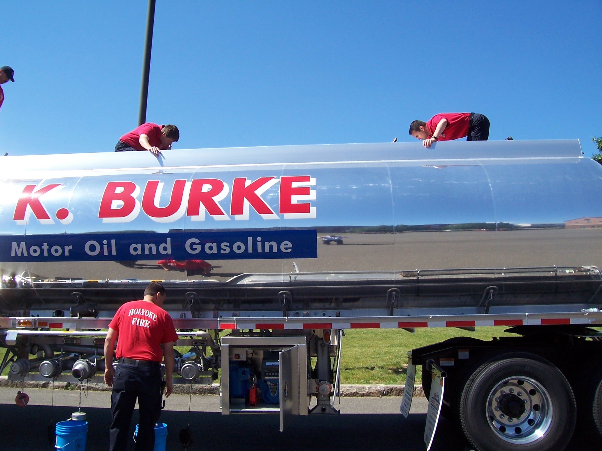 Fire fighter working the controls of a refueling truck