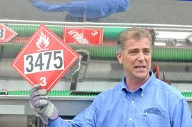 Matt Manoli holding up a hazardous materials tag
