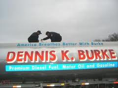 Two firefighters on top of a Dennis K. Burke refueling truck training