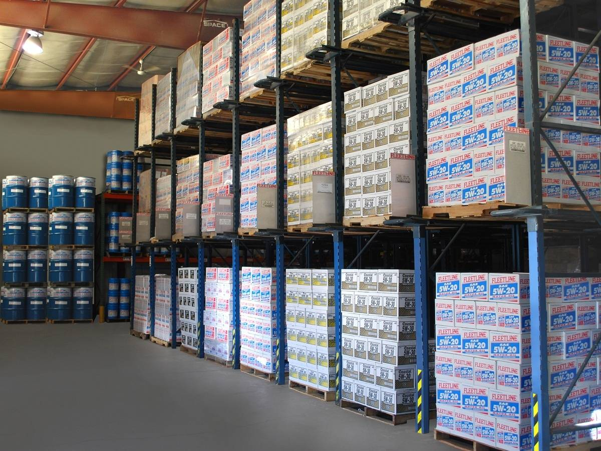 Warehouse racks stocked with various engine lubricants