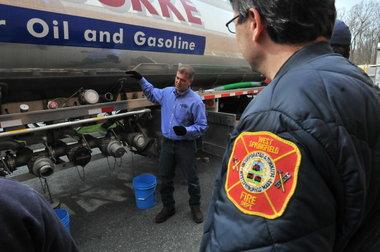 Fire fighter observing a lecture from a Dennis K. Burke driver
