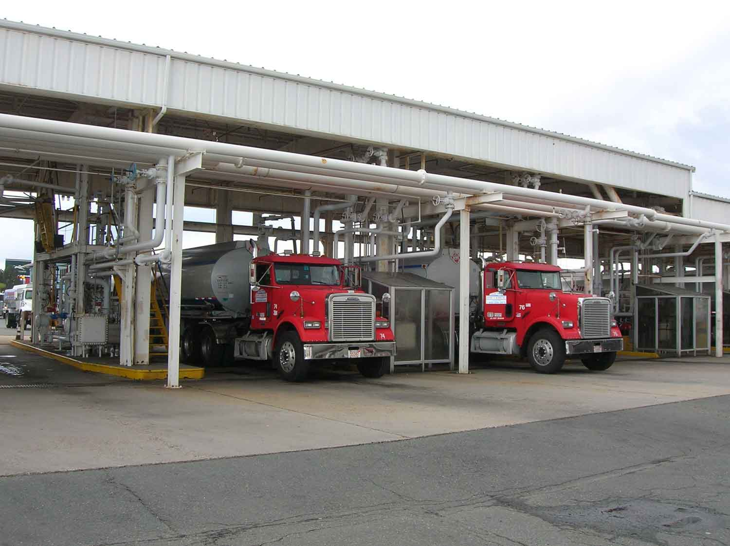 Two fueling trucks being filled up
