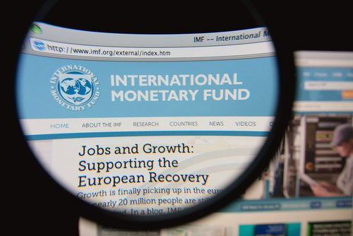 Magnifying class showing the Internation Monetary Fund logo