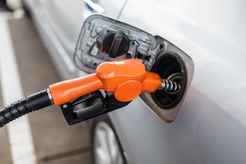 Fuel pump filling up a commuter car