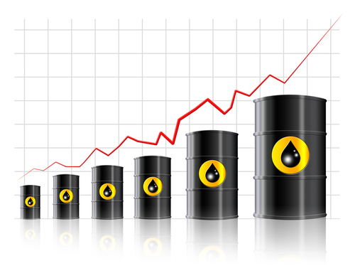 Oil barrels laid over an upwards growing line chart