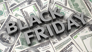 Black Friday overliad on 100 dollar bills