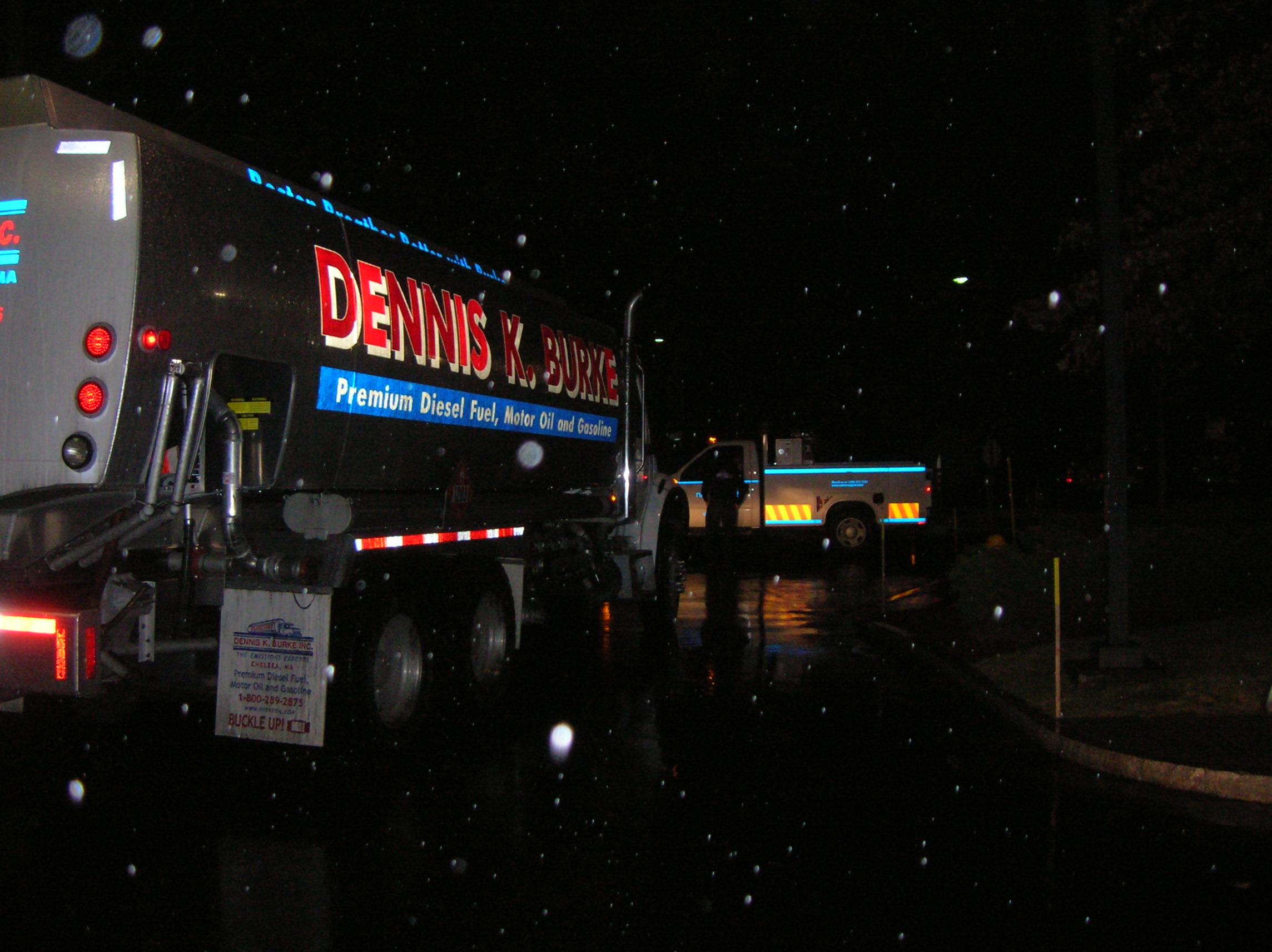 Dennis K. Burke refueling truck performing an emergency refueling at night