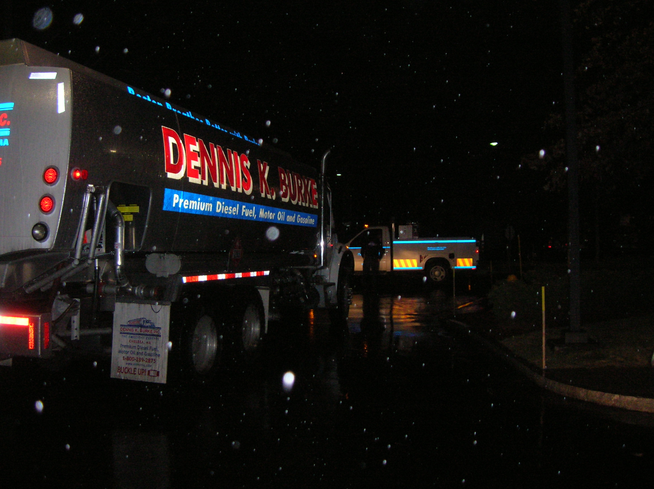 Dennis K. Burke refueling truck performing an emergency refueling at night