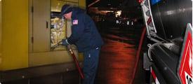 Driver fueling a customer of Dennis K. Burke's generator fuel program