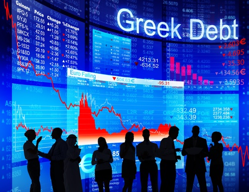 Sillouettes of people infront of charts showing Greek Debt