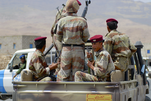Soldiers on the back of a pickup truck