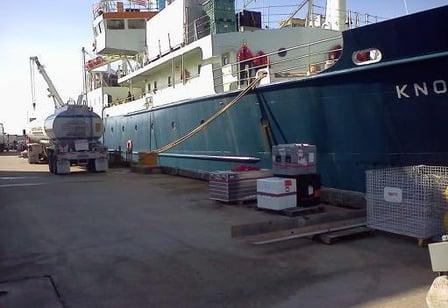 truck w cargo ship